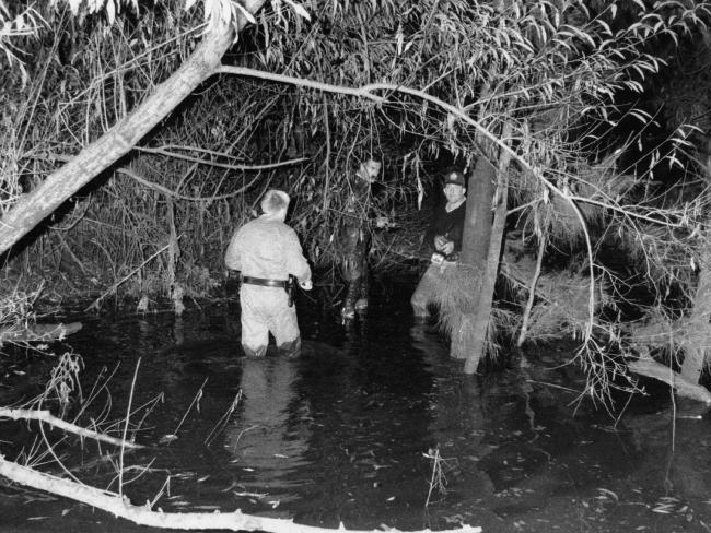 Officers in the creek near where Lauren's body was found and her clothes were hanging on a tree.