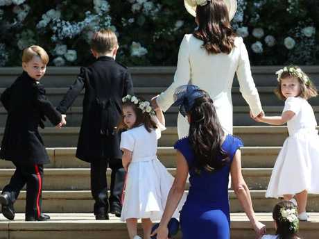 Prince George looks over his shoulder at the cameras. Picture: AFP PHOTO / POOL / Jane Barlow