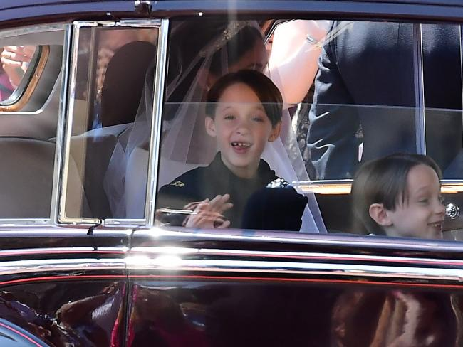 Page boys John and Brian Mulroney look excited as they arrive for the royal wedding. Picture: Ian West/AFP.