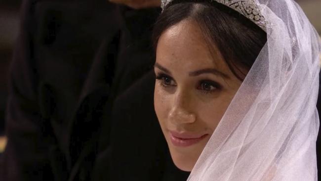 Meghan Markle arrives at St George's Chapel for her wedding to Prince Harry. (UK Pool/Sky News via AP)