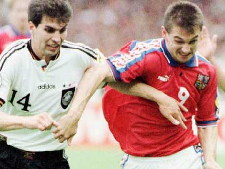Germany's Markus Babbel competes for the ball against the Czech Republic's Pavel Kuka at Euro '96.