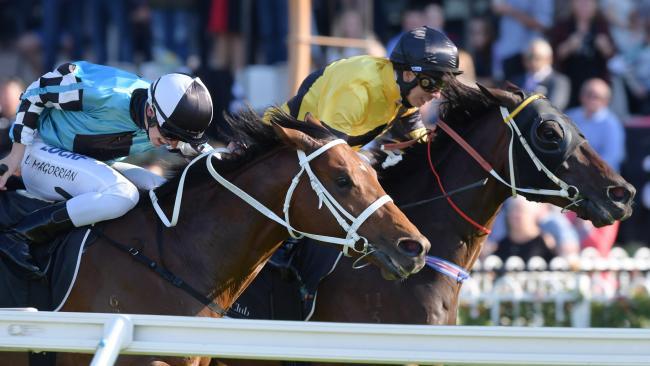 Jockey Jean Van Overmeire steers The Getaway to victory. Picture: AAP