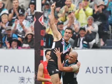 Tom Rockliff celebrates a Port Adelaide goal.