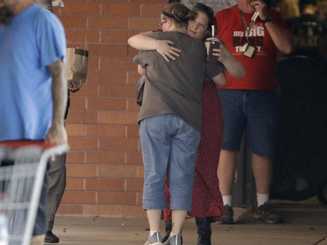 Locals embrace outside the unification center at the Alamo Gym following the shooting. Picture: AP Photo/David J. Phillip