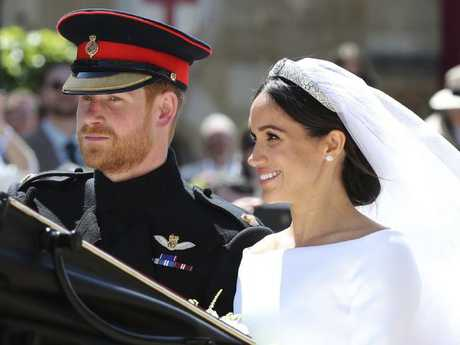 The Duke and Duchess of Sussex departed Windsor Castle for a procession through the streets. Picture: AP