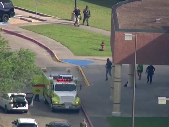 In this image taken from video law enforcement officers respond to a high school near Houston. Picture: AP