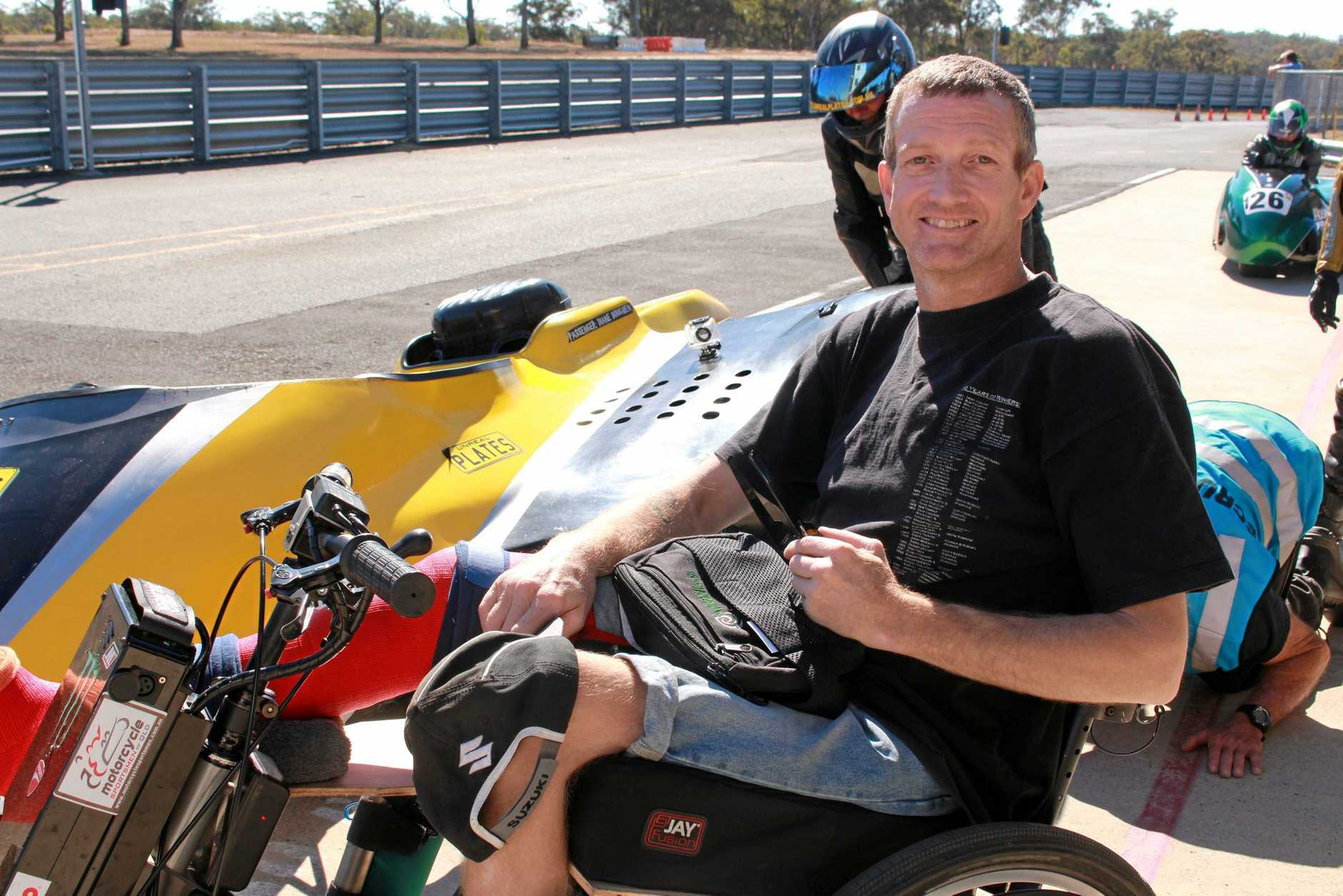 BIG HEART FOR RACING: Andrew Phillips wouldn't dream of giving up the sport that keeps him grinning. Two years after becoming a T12 paraplegic, he is clocking up race times faster than ever and improving every day.