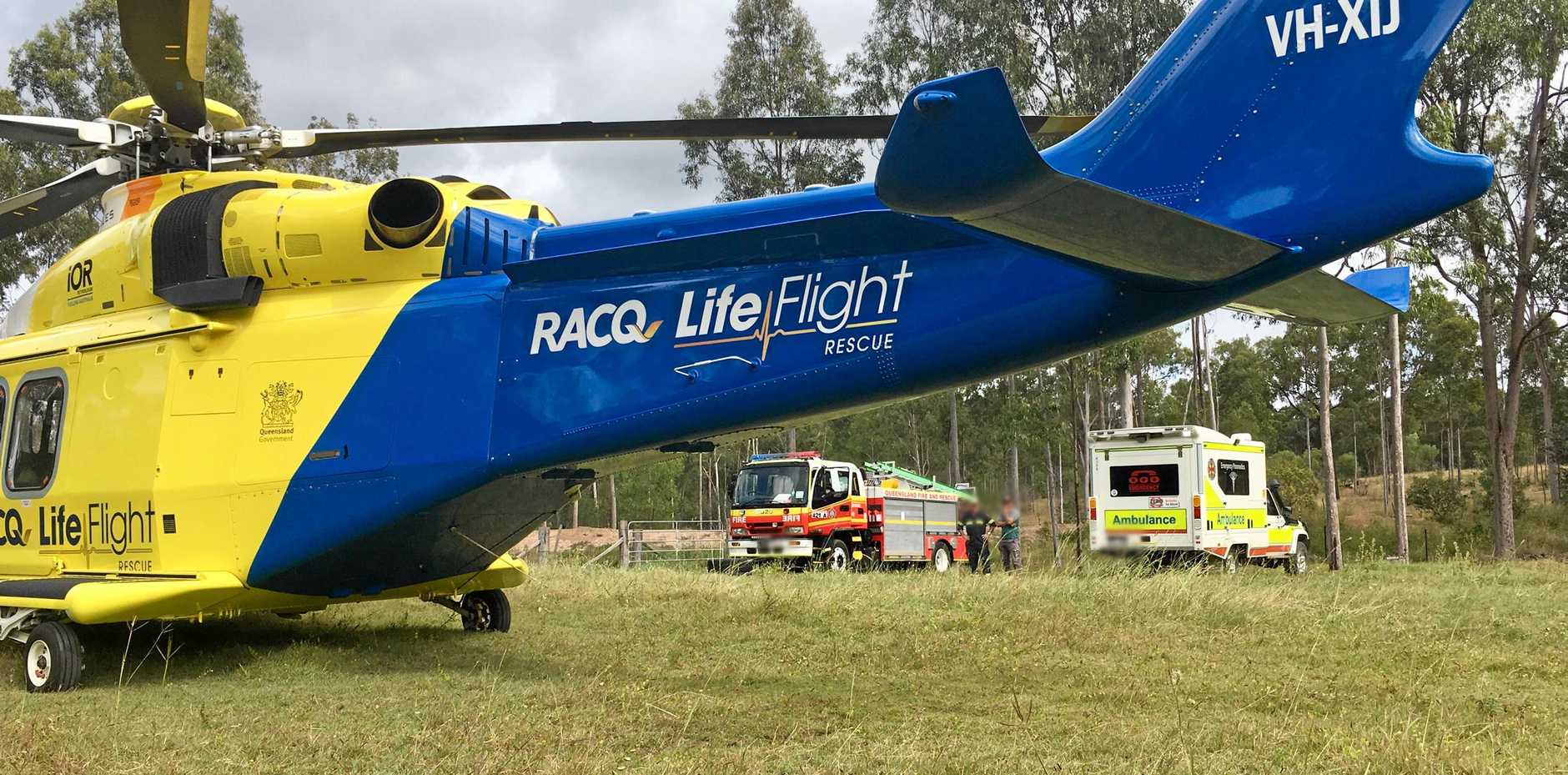 RESCUE: RACQ LifeFlight crew and emergency services at the scene of the accident, a property near Biggenden.