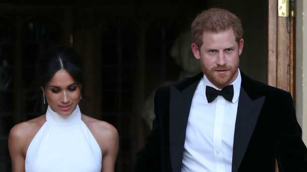 Harry and Meghan changed their outfits as they headed to their wedding reception. Picture: Harry, Meghan depart Windsor Castle for evening reception AFP PHOTO / POOL / Steve Parsons