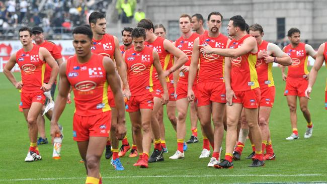Gold Coast walk off after losing to Port Adelaide in China.