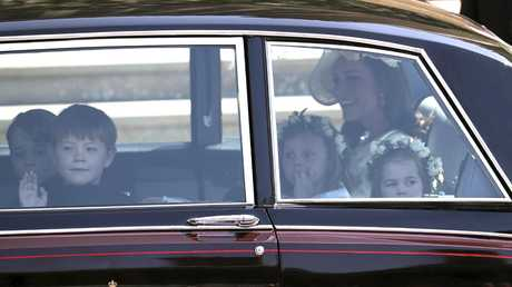 Kate, the Duchess of Cambridge arrives with Prince George, left and Princess Charlotte, right, for the wedding. Picture: AP