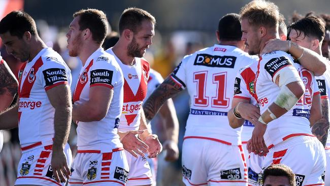 Jack De Belin celebrates a try with his Dragons teammates.