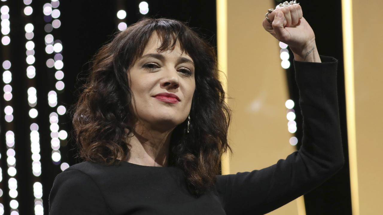Actress Asia Argento raises her fist on stage during the Cannes closing ceremony. Picture: Vianney Le Caer