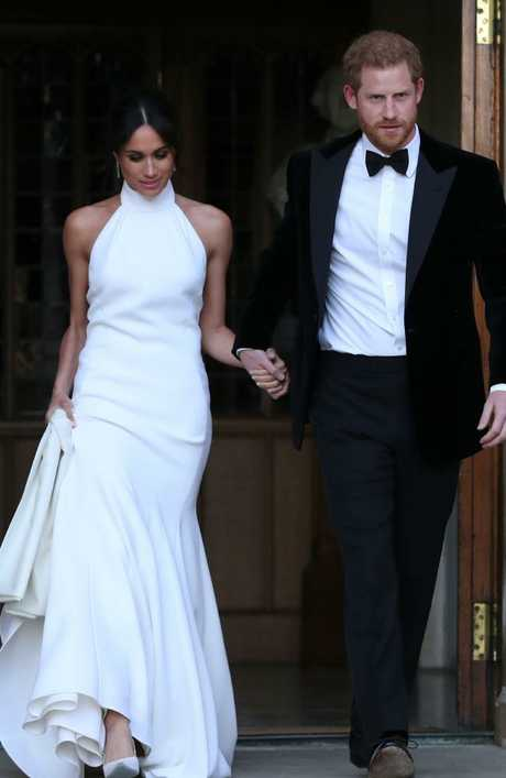 The newly married Harry and Meghan Markle eave Windsor Castle after their wedding to attend an evening reception at Frogmore House. Picture: AFP PHOTO / POOL / Steve Parsons
