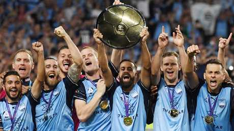Alex Brosque lifts the Premiers trophy with Sydney FC.