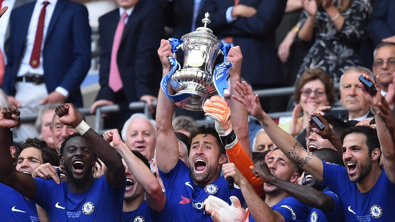 Gary Cahill lifts the trophy as Chelsea players celebrate their FA Cup final win over Manchester United at Wembley.