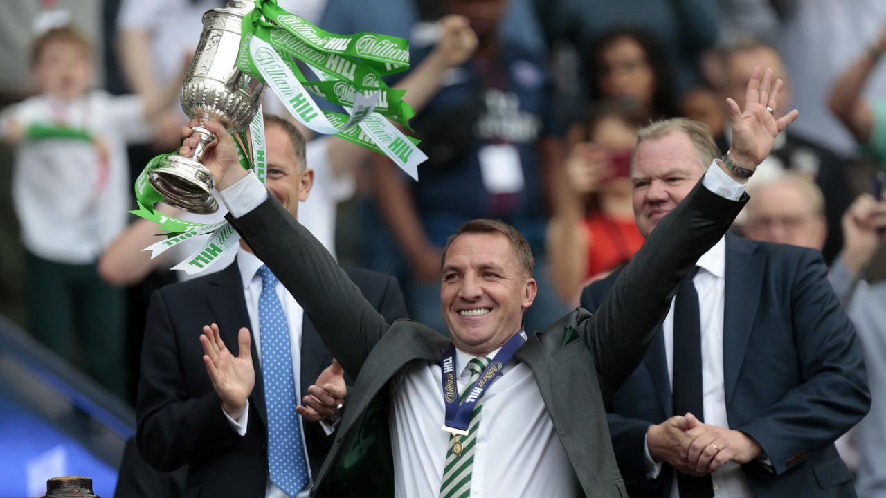Celtic manager Brendan Rodgers lifts the Scottish Cup.