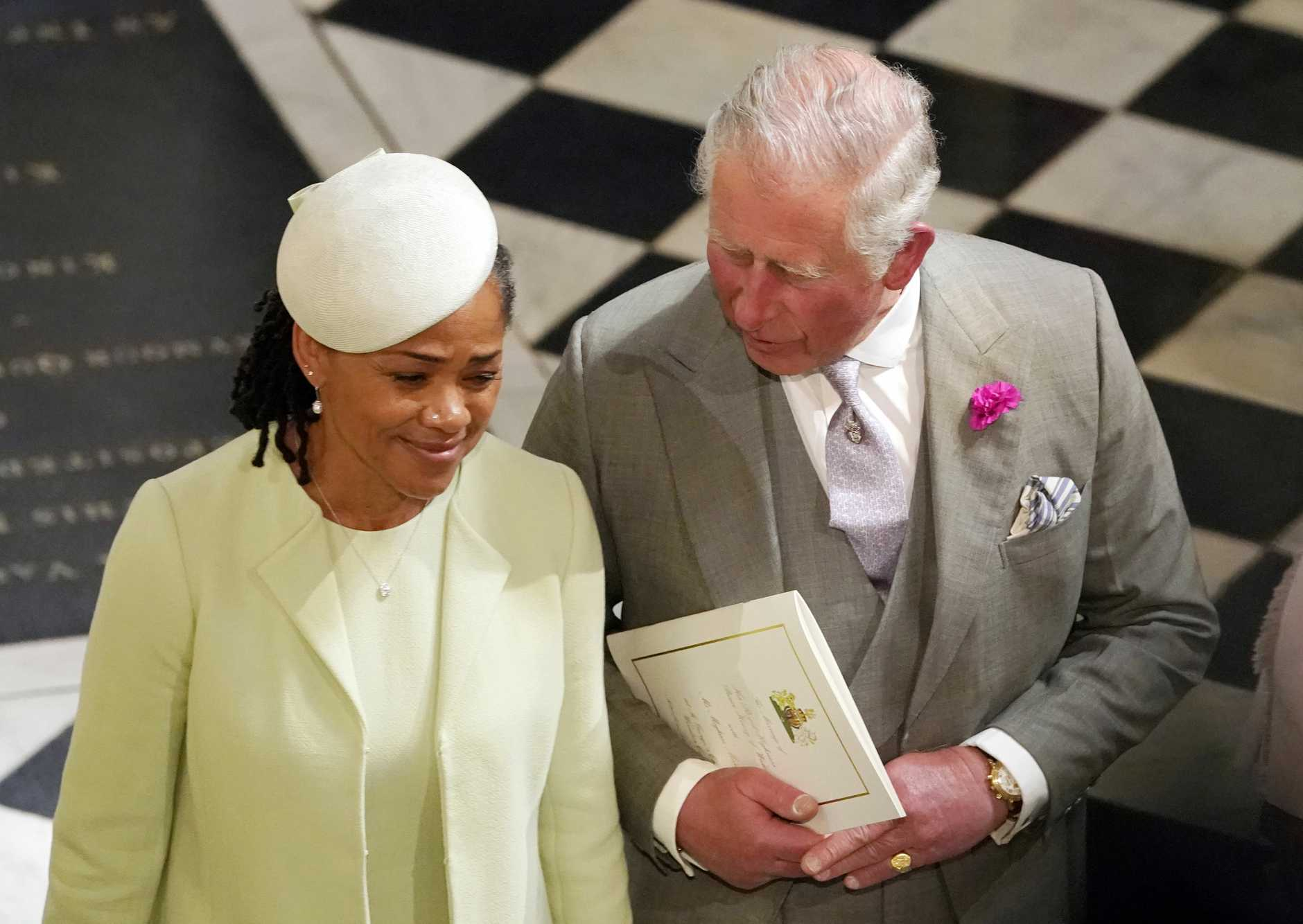Prince Charles and Doria Ragland, mother of the bride, depart after the wedding ceremony. Picture: Owen Humphreys/AP/POOL PA