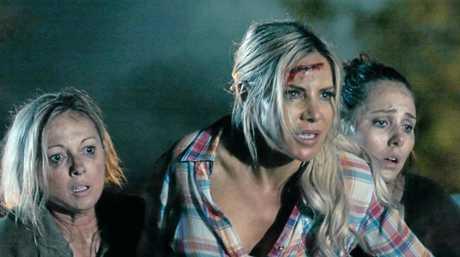 Simone Buchanan, Melissa Tkautz and Christie-Lee Britten in Boar, a new horror film by writer and director Chris Sun.
