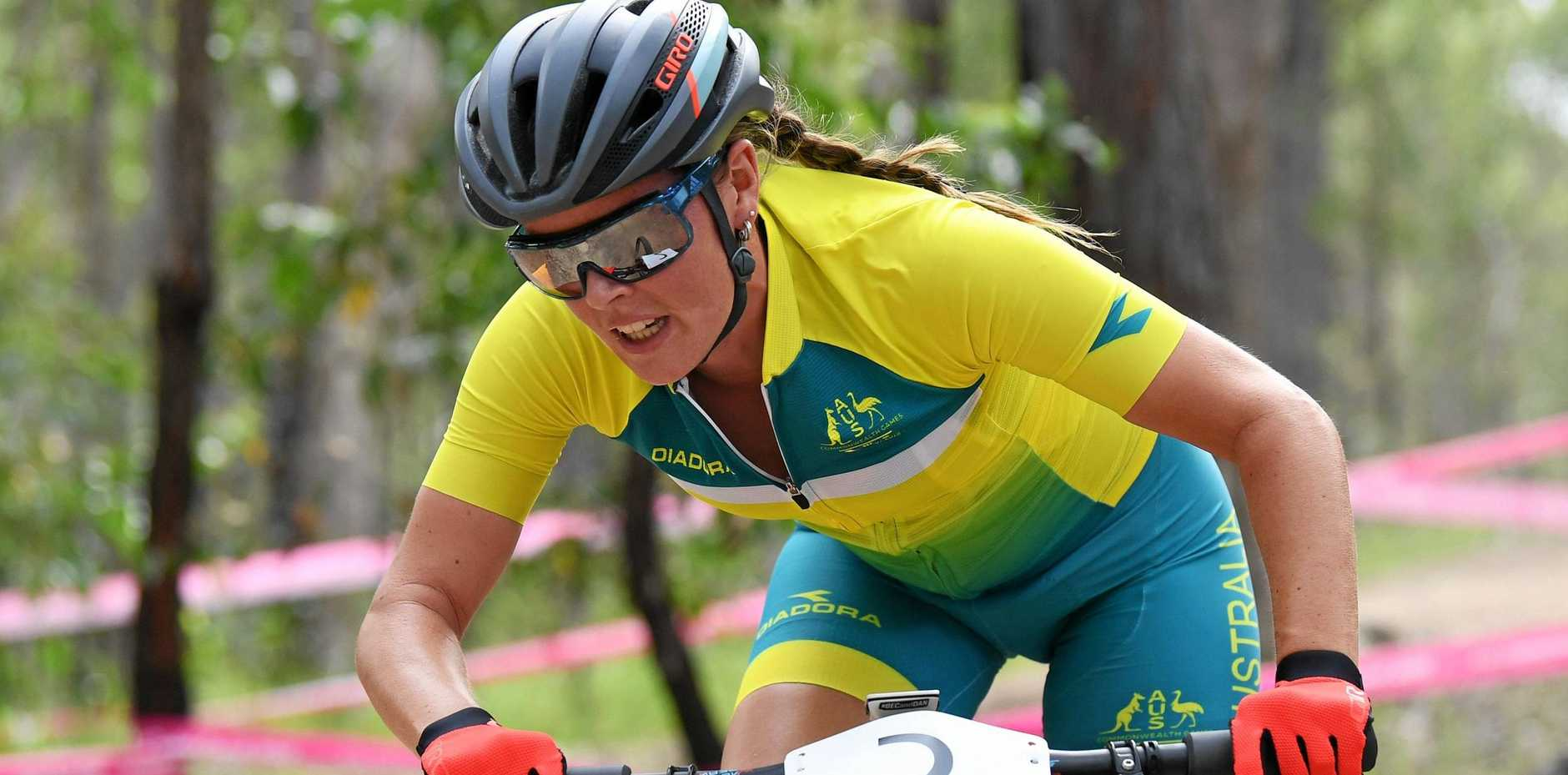 Rebecca McConnell of Australia during the Women's Cross Country Mountain Bike Final on day eight of competition of the XXI Commonwealth Games at Nerang Mountain Bike Trails, on the Gold Coast, Thursday, April 12, 2018. (AAP Image/Tracey Nearmy) NO ARCHIVING, EDITORIAL USE ONLY