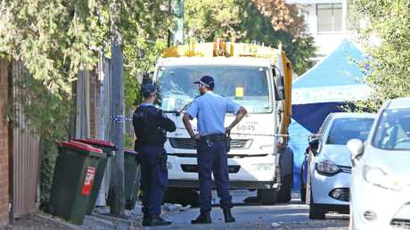 Police at the crime scene. Picture: Richard Dobson