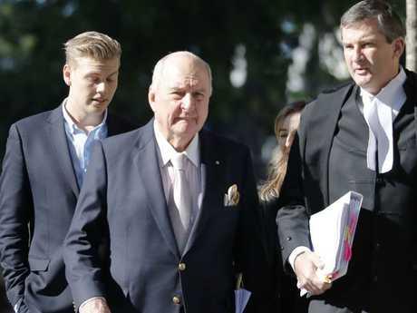 Broadcaster Alan Jones (centre) enters Brisbane Supreme Court last Friday. Picture: Glenn Hunt/AAP