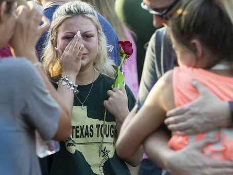 A woman wipes away tears during a prayer vigil following a shooting at Santa Fe High School in Santa Fe, Texas. Picture: AP