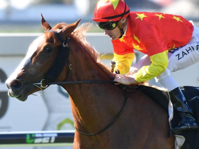 Paul Snowden's Eawase takes out the Bill Carter Stakes on Doomben Cup Day. Picture: AAP