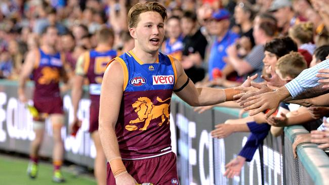 Alex Witherden celebrates Brisbane's win with the fans.