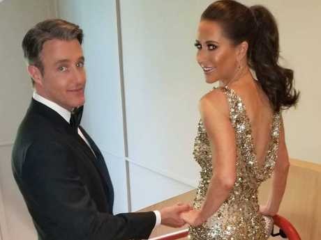 Ben and Jessica Mulroney pose for a picture before heading to Meghan Markle's evening reception.