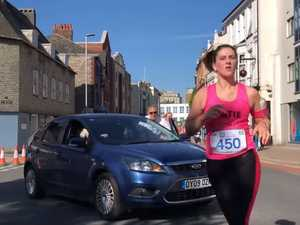 WATCH: Driver defends driving into group of runners