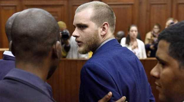 Henri van Breda is led out of the High Court in Cape Town, South Africa, Van Breda was found guilty of the murder of his parents and the attempted murder of his sister, more than three years after the gruesome attack. Photo: Nasief Manie /  AP