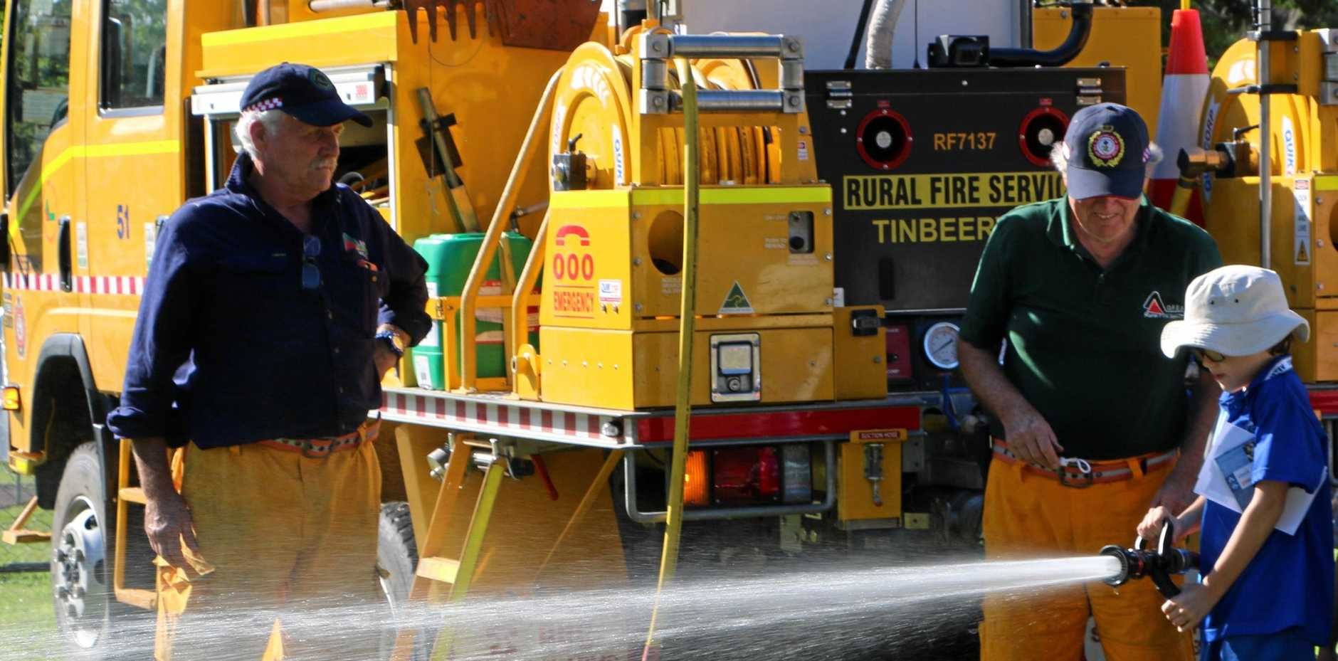 FRIENDLY SPRAY: Fire fighting is hands on at Under 8s day at Tewantin State School.