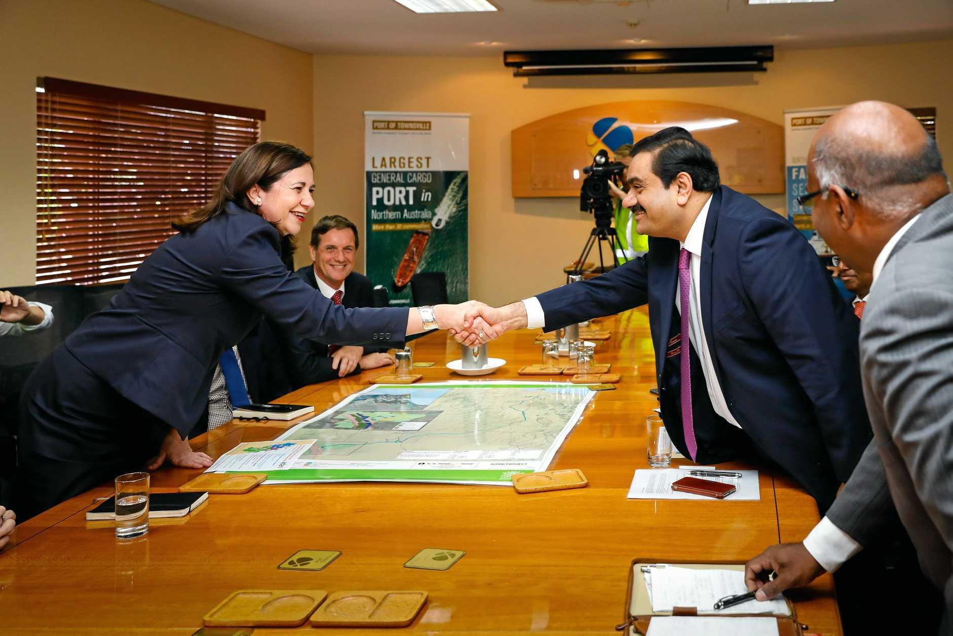 Adani Group chairman Gautam Adani meets with Queensland premier Annastacia Palaszczuk at the Port of Townsville in 2016.