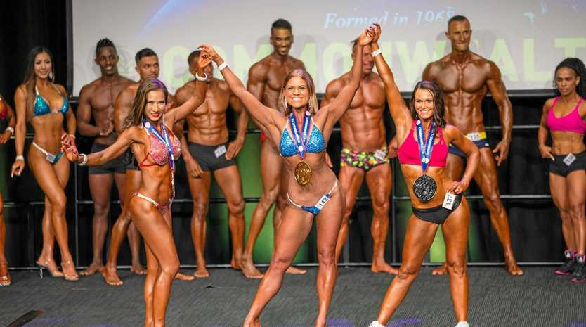Stacey O'Malley on stage in April winning first place in the fitness model category of the PCA competition.
