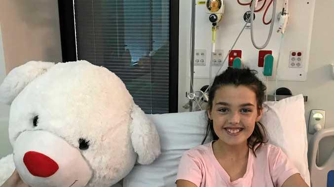 Schoolgirl conquers 10kg tumour
