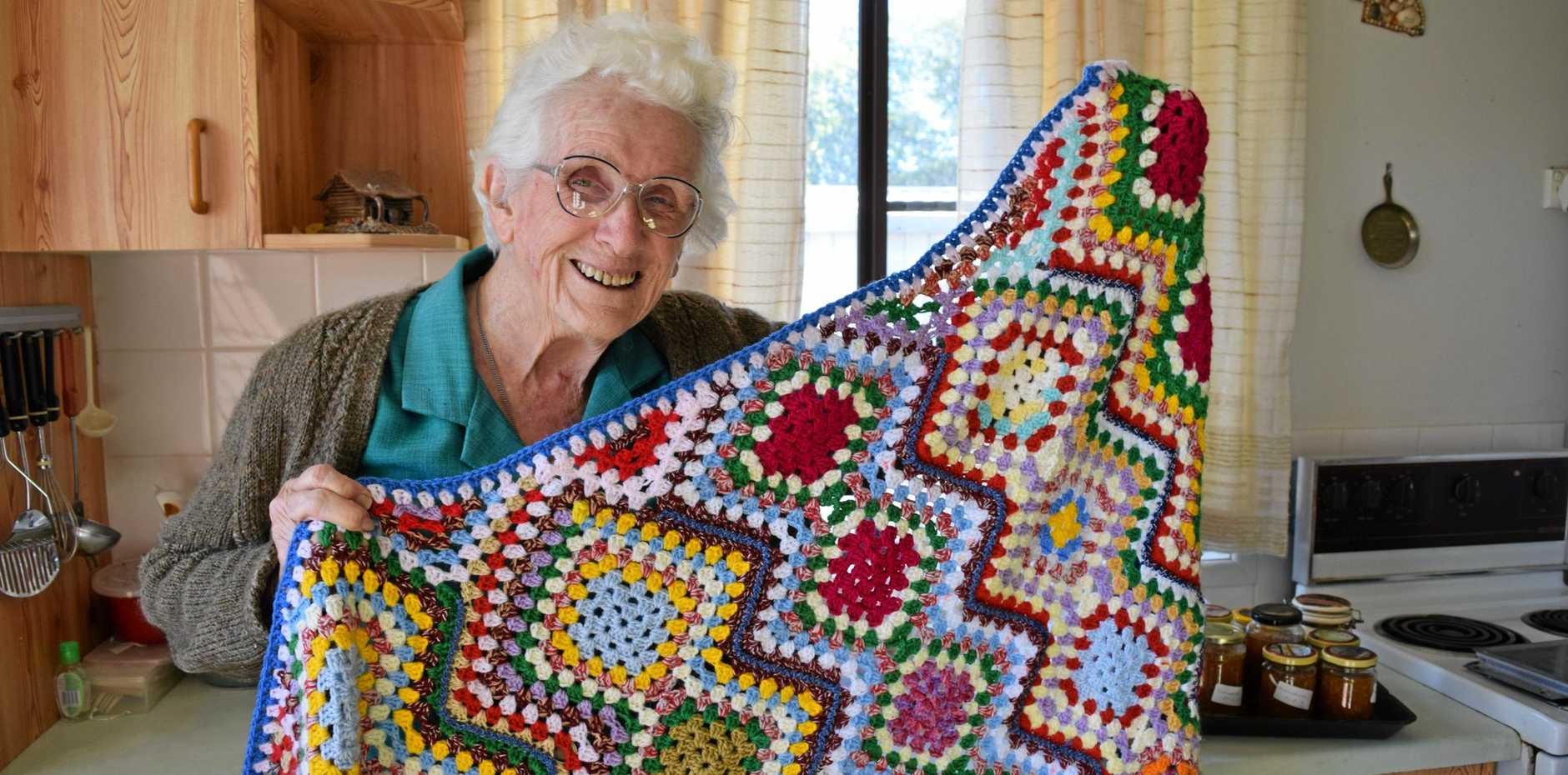 RUG BUG: Betty Sommerville at home with her 167th crocheted rug, which earned her a second placing in a recent CWA competition.