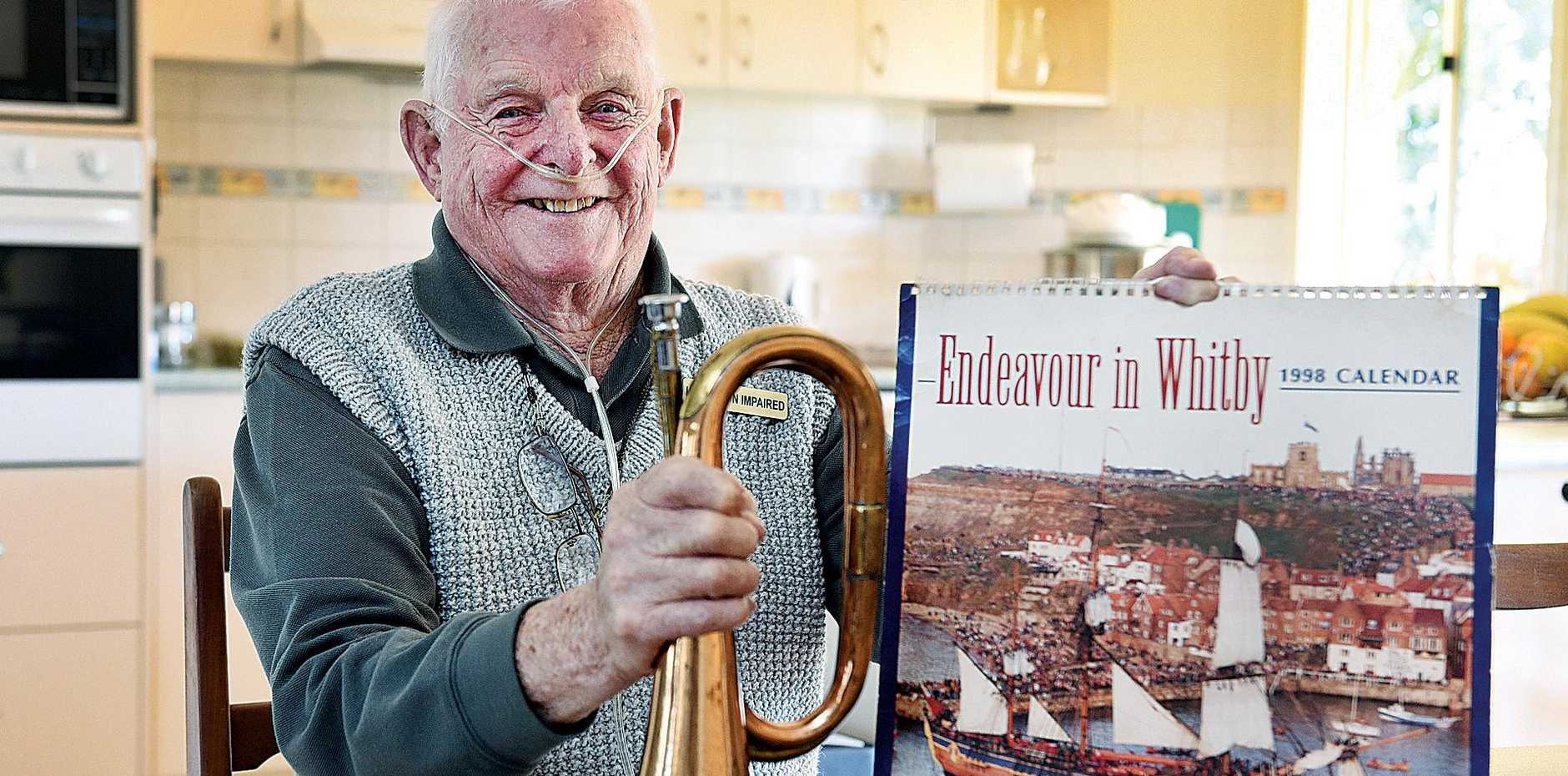 SOUNDS & SEA: Frank Revill with two items which sum up his life - a bugle and an Endeavour calendar.