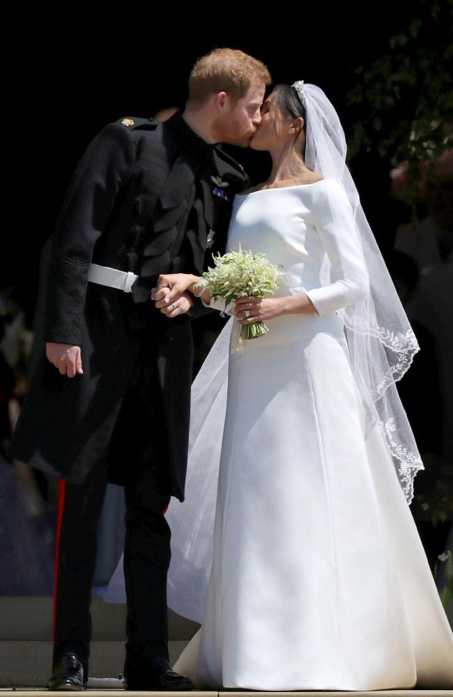 Meghan and Harry married with her mother Doria Ragland the only family member present. Picture: Givenchy/ MEGA