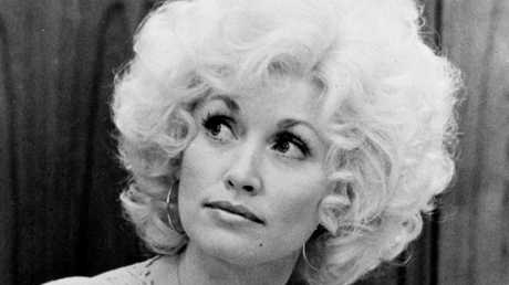 Natural Dolly Parton in a scene from the movie 'Nine To Five'.