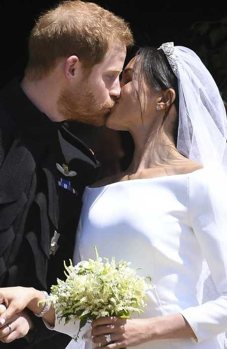 The happy couple share their first kiss as husband and wife.