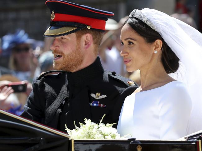 Prince Harry and wife Meghan Markle leave their wedding ceremony on Saturday.