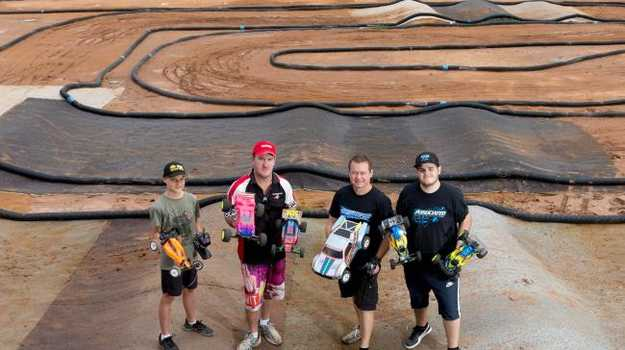 Chargers Remote Control Club members at their new Carole Park off-road track. IMAGE: AAP/Richard Walker
