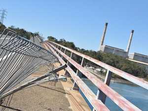 UPDATE: Truck crashes into barrier on Calliope River bridge