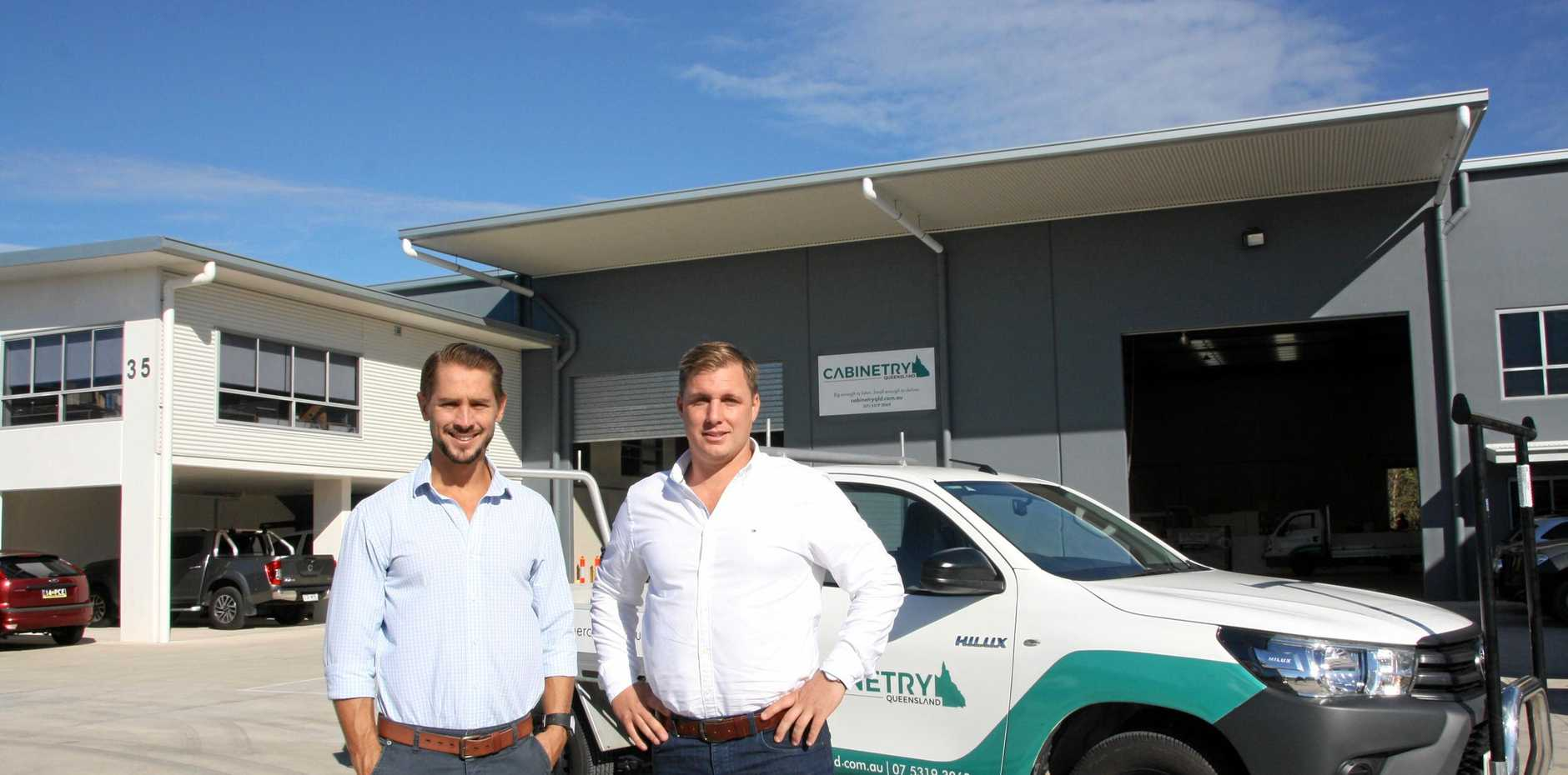 READY FOR BUSINESS: Peter Capps of Savills with Cooper Small managing director Beau Small on site at 35 Access Cres, Coolum Beach.