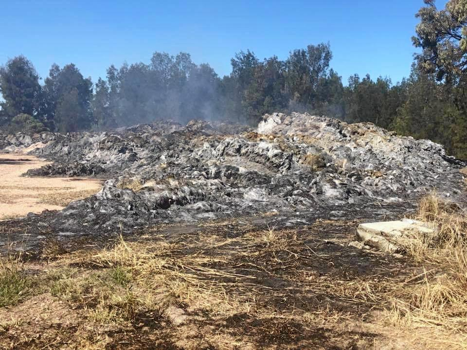 AFTERMATH: The fire destroyed hay worth in excess of $100,000 and also damaged a trailer.