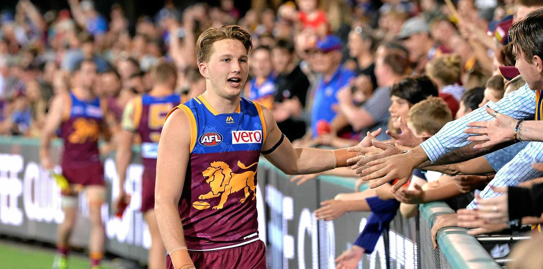 FANS-TASTIC: Alex Witherden celebrates with fans after the Lions downed the Hawks.