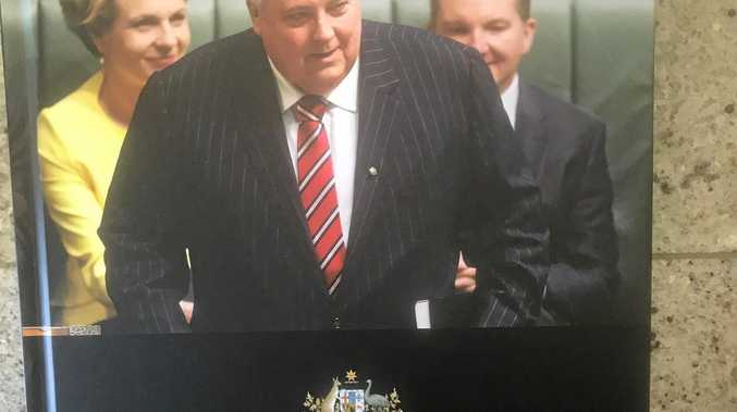 CLIVE PALMER: The reason behind the distribution of copies of a  book  to the Parliamentary press gallery detailing Clive Palmer's  one-term political career  has been revealed.