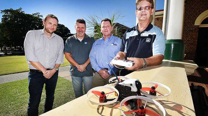 FLYING HIGH: Autonomous Technology CEO Andrew Bradshaw, Bruce Bell of Skills Generation and Graeme Nagle of Osprey Imagery with Head of Technology at MSHS Gavin Grantz and one of the drones that students will build and learn to fly from July 2018.
