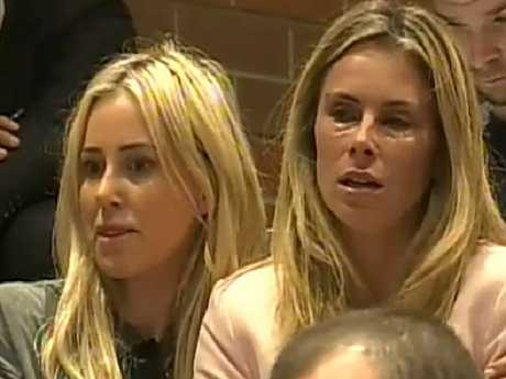 A tearful Candice Warner is comforted by Roxy Jacenko at husband David's press conference.